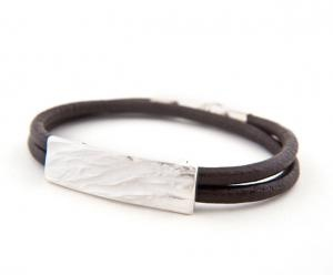 Latham and Eve: Dune Leather Bracelet.  A textured slab of silver, shaped to fit the wrist, fixed to a chunky, dark leather double thong, this clever and tasteful take on the identity bracelet gives a tough, contemporary feel to any outfit.