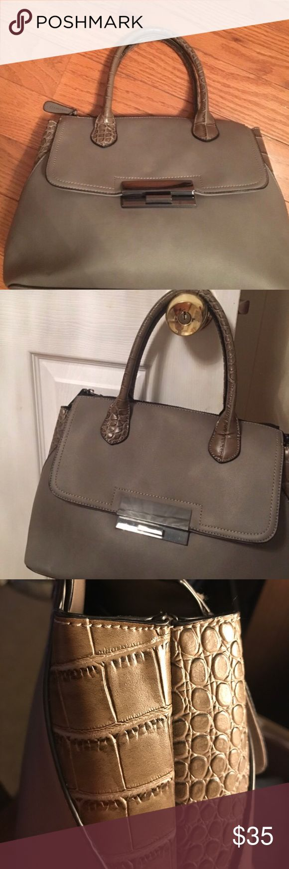 Aldo handbag Great Aldo handbag. Color is grayish, taupe? The sides have some sort of croc print and it looks more army green colored. Overall a really nice neutral bag. Barely used,no real signs of wear or tear. Inside is clean as well. Aldo Bags Totes