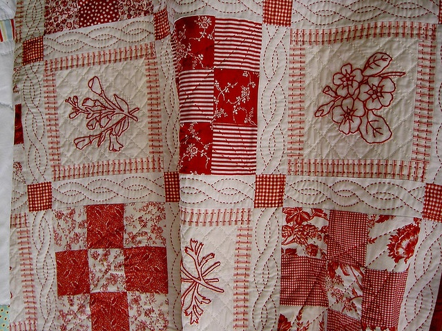 love the layout! and the way the red work is presented! ..and the quilting…