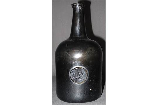 LATE 18TH CENTURY MALLET SHAPED, GLASS, SEALED WINE BOTTLE, the seal with initials: I.H., dated: