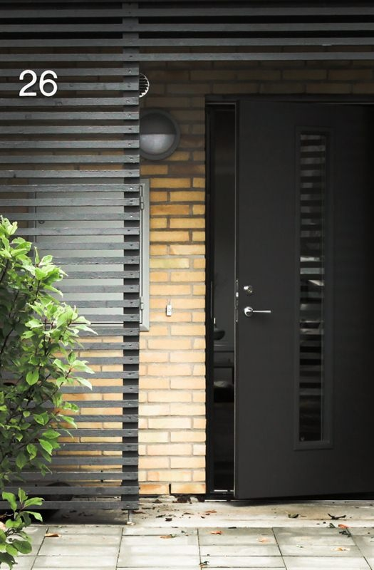 Black slat exterior with simple house numbers dramatic for Minimalist house numbers