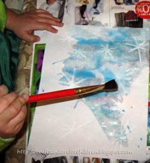 A fun snowflake craft using white colored pencil and water color paints to make a winter scene.