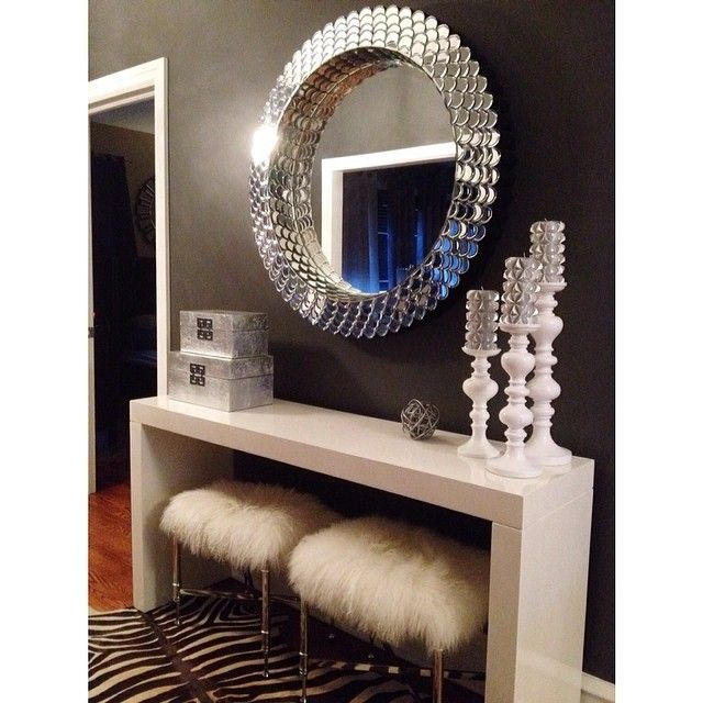 Glam entryway. Features Ming Boxes, Aluminum Knot, Studded Candles & Mariposa Pillar Holders. Black walls, white furry benches, zebra cowhide!