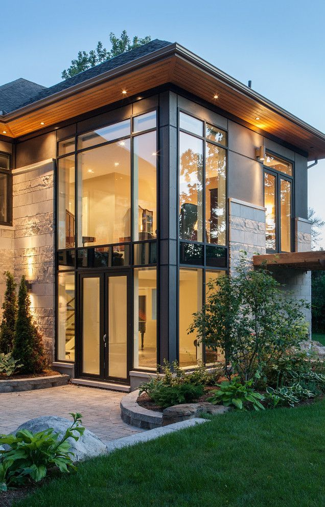 Straight Lines....Large Long Windows...Such a Modern Home...yet with the black trim it looks cozy and warm. Would Love for it to be my Dream Home!