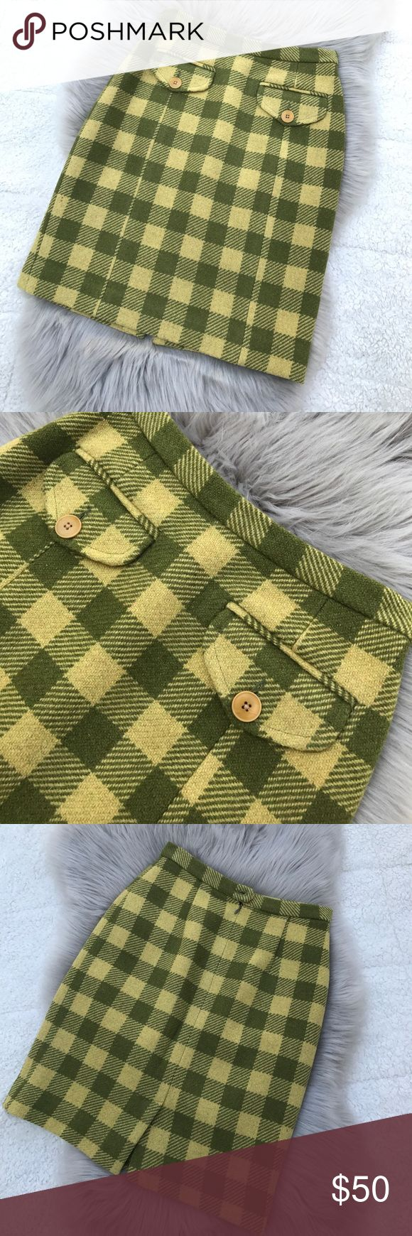 BANANA REPUBLIC Women's Wool Plaids Skirt Sz 2 Like brand new A Line Wool Plaids skirts. Size 2. Waist to hem is 20 inches. The Zipper has been changed to brand new YKK Zipper and has been dry clean. Color is green and yellow green. Price is firm due to alterations on Zipper and dry clean cost to protect the fabric, thank you. Banana Republic Skirts Midi