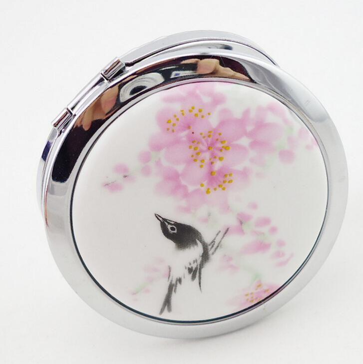 gut aussehende chinesische kunst spiegel keramik und metall kompakte tragbare kosmetikspiegel
