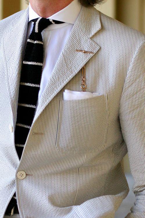 Seersucker suit, spread collar, knit tie, white handkerchief, pocket watch. Good.