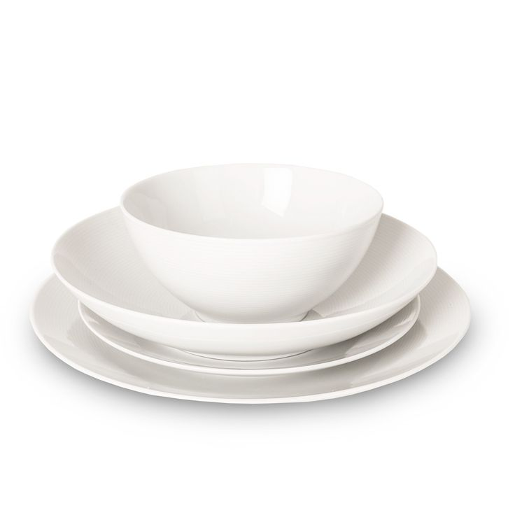 Elegant white tableware never goes out of fashion, especially when it's as simple and understated as the Loft range. Designed in Germany by Thomas Rosenthal and crafted by expert ceramicists Queensbury Hunt,  this minimally styled china porcelain dinnerware set is a timeless classic. Dinner ware set contains four Dinner Plates, Soup Plates, Side Plates and Round Bowls.