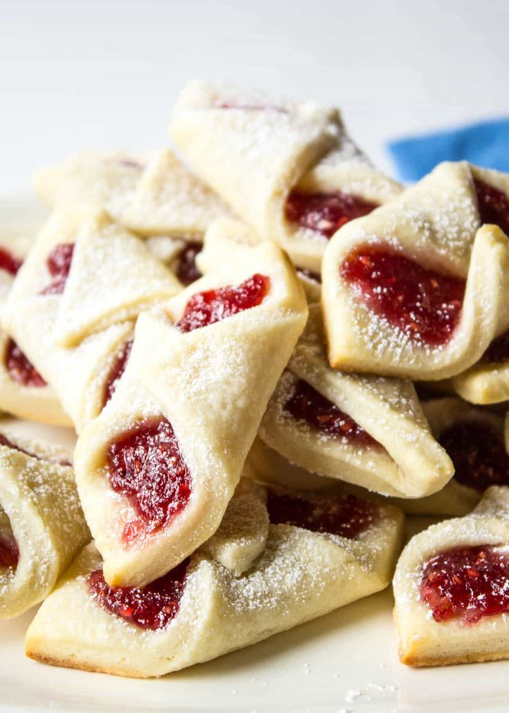 Raspberry Bow Tie Cookies are a perfect cookie to add to your holiday cookie platter!