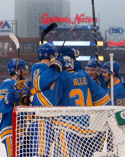 Blues vs. Blackhawks - 01/02/2017 - St Louis Blues - Photo Galleries  Patrik Berglund #21 of the St. Louis Blues hugs goal keeper Jake Allen #34 as teammates congratulate each other on their 4-1 victory against the Chicago Blackhawk