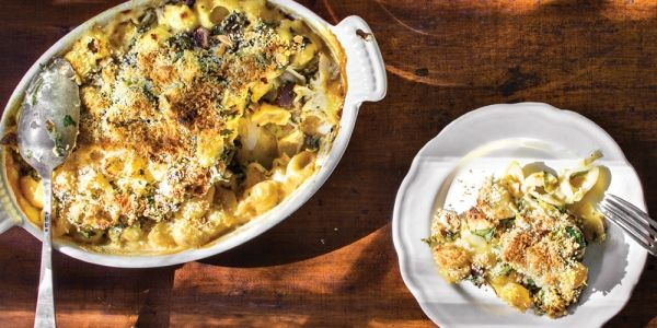 Beroemd, berucht en Italian American: de mac 'n cheese is de godfather onder de pasta's. Deze variant van Tal Maes – met paddestoelen en spinazie – v...