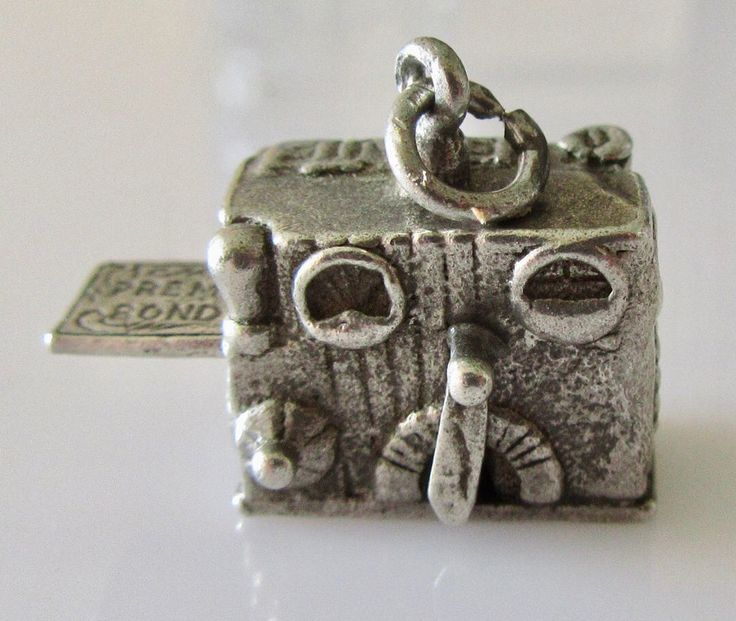 Silver Ernie Premium Bonds Machine Articulated Charm by TrueVintageCharms on Etsy https://www.etsy.com/listing/521549341/silver-ernie-premium-bonds-machine