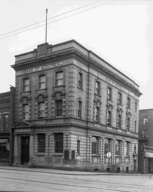 https://flic.kr/p/t47jfb | Bank of Montreal | Date: c. 1940s Description: Located at 27 Cumberland Street, on the corner which intersects with Park Avenue, the building in this photograph is still visible today. It was constructed in 1913 to house Molsons Bank which was absorbed by Bank of Montreal (BMO) in January 1925. Today it is home to the Prospector Steak House. The Ontario Bank was the predecessor to BMO in Thunder Bay. It was established in 1875 with D.F. Burke as the manager and...