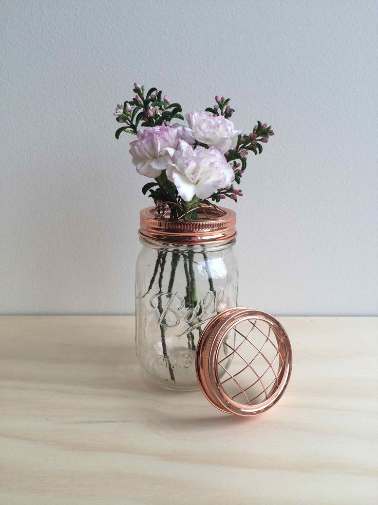 A beautiful ball mason flower jar featuring a copper lid designed especially for flower arranging.