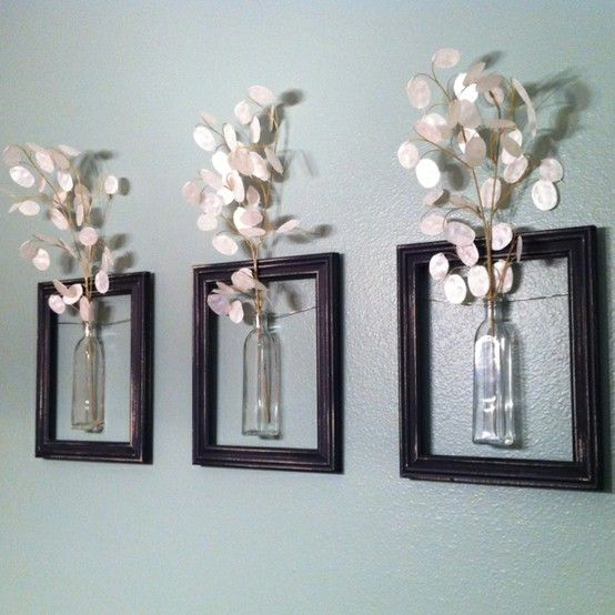 So cool and DIY! Dollar store frames and vases, wrapped with floral wire around the vases and secured with a dot of glue. Added floral stems in the top and hung in my bathroom.
