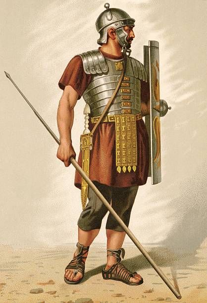 Illustration shows a Roman dressed armor a helmet and sandals and carrying a spear and shield