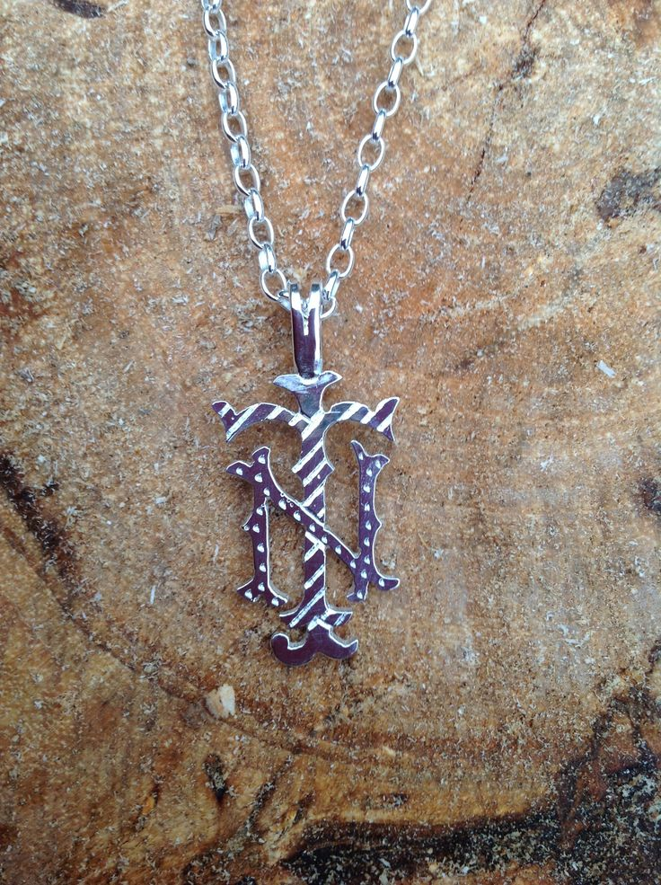 A sterling silver JNT monogram was made for my client in Tasmania. Finished with a sterling silver chain. It comes presented in a beautiful pendant and makes a unique and personal gift.  My name is Alison, for more information on monograms and other pieces I make please go to  http://www.etsy.com/shop/PearlsByDesign