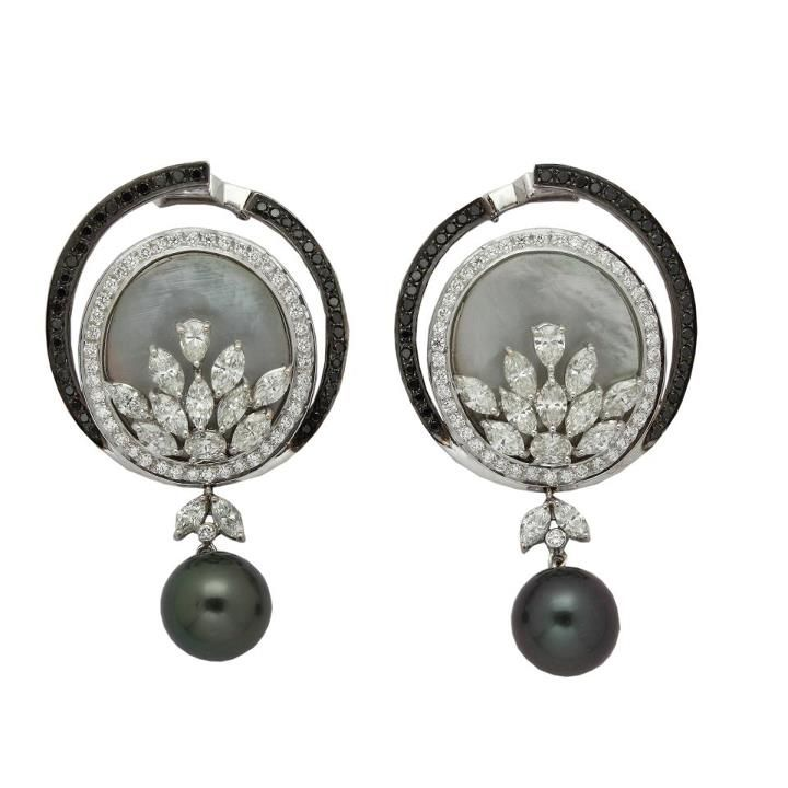 Drop Dead Gorgeous This pair of earrings by Anmol Jewellers is crafted in 18 K gold and set with Mother-of-Pearl, south sea pearls, black diamonds, marquise, drop diamonds and round brilliant diamonds.