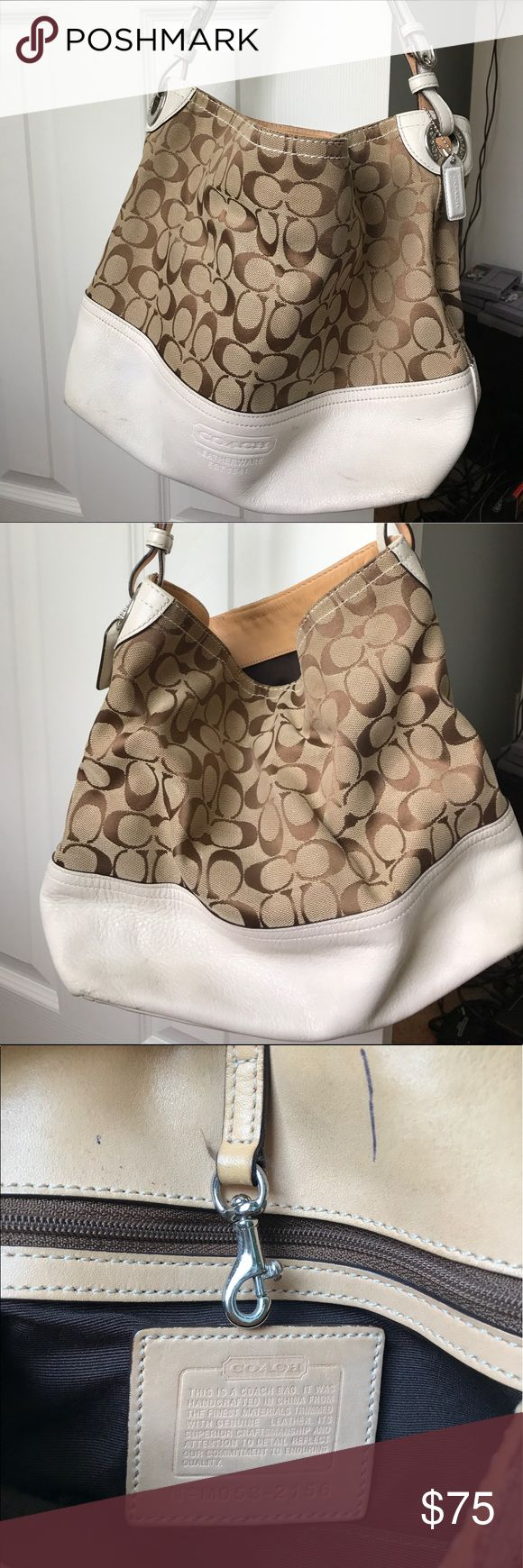 Coach hobo bag Camel colored Coach shoulder bag. Definitely signs of wear... they might be able to. One out with some minor cleaning. No tears or holes in bag. Other than minor marks on the bag it's in very good condition. Coach Bags Shoulder Bags