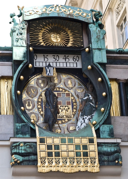 Vienna Ankeruhr Clock. The clock is actually a bridge that connects the two buildings. It was built between 1911 and 1914 according to the plans of Art Nouveau painter Franz Matsch .