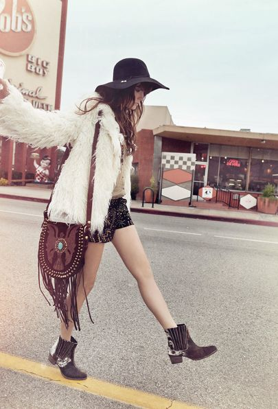 Hippie style winter threads. Shaggy coat, studded shorts, tasselled boho bag, edgy ankle boots & floppy felt hat.