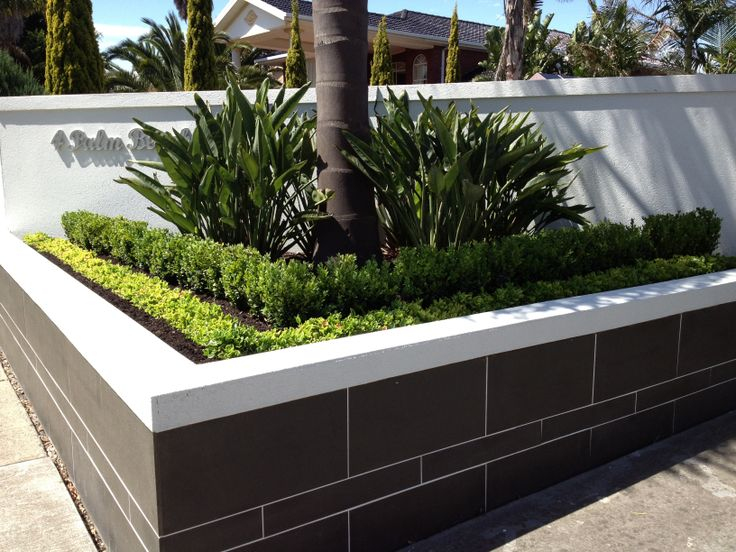(4) After photo- rebuilt retaining wall , gave entrance a luxury feel using slate tiles and render. Added some box hedge and bright pink flowering succulent border to give it some wow factor. Result very happy customer .  Patterson Lakes Melbourne