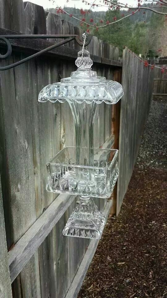 Old glass candy dishes repurposed as bird feeders