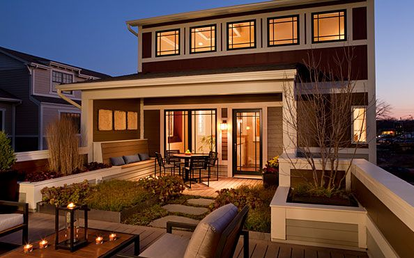Great design on the back of this house...  beautiful windows and I love the even flow from indoor to outdoor living...