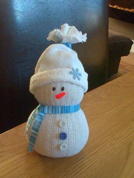 Here is a sock snowman...made using white socks,elastic bands,buttons,brads,ribbon & filled with rice.