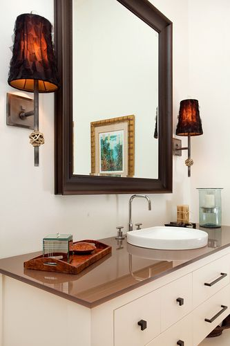 Bathroom with glass countertops by In Detail Interiors. Love the lighting fixtures also.