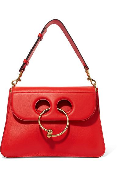 """""""When it comes to accessories, you should consider red the new neutral; after all, it's a color that works with every other classic shade,"""" suggests PORTER. A cult style seen on the arms of nearly every fashion insider, J.W.Anderson's 'Pierce' bag is defined by its cutout front and chic gold barbell. Detach the shoulder strap to carry it as a clutch."""