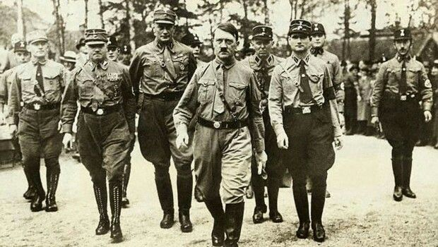 Hitler and his men on there way to poland. Brintain and france made the appeasement policy to get more time to prepear and recover and rebuild from all the distruction caused by ww1