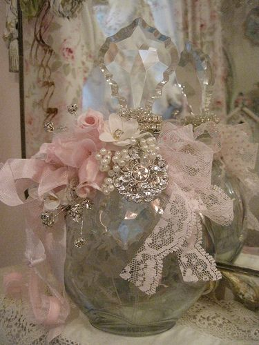 Beautiful bottle adorned with beautiful rhinestones, pearls and soft pink roses.