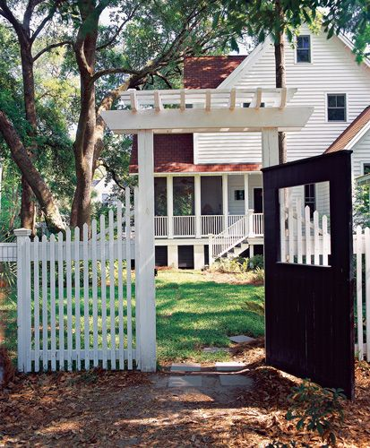 south carolina home and gardena charming trellised gateway and picket fencing screens the driveway - Carolina Home And Garden Magazine