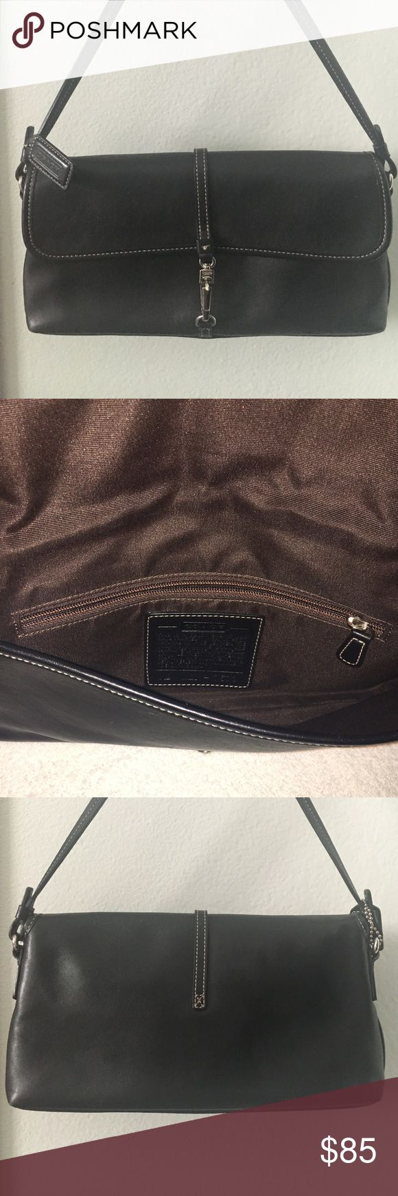 Coach Leather Clutch/Shoulder Bag Coach Black Cowhide Leather Bag with silver hardware. Could be used as a Clutch or a Shoulder Bag. Measures 10.5 x 5 inches. 7 inch strap. Gently used. No marks inside or outside of the bag. Coach Bags Shoulder Bags