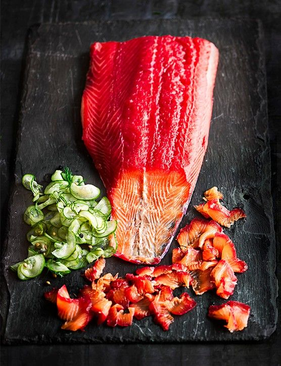 Beetroot and gin-cured salmon Try our on-trend zesty and boozy gravadlax, perfect for lunches, canapés or as a showstopping centrepiece. Wear gloves when you're grating the beetroot to avoid getting stained hands http://www.olivemagazine.com/recipes/fish-and-seafood/beetroot-and-gin-cured-salmon/