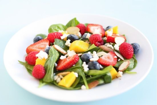 spinach salad with fruit, almonds, and feta cheese (or try goat cheese instead), and a side of raspberry vinaigrette