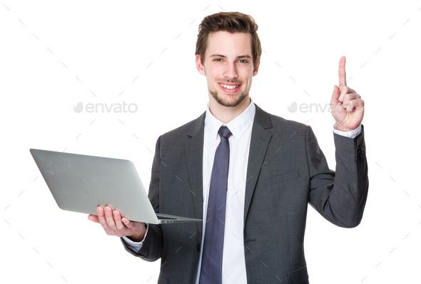 Caucasian businessman use of laptop and finger point up