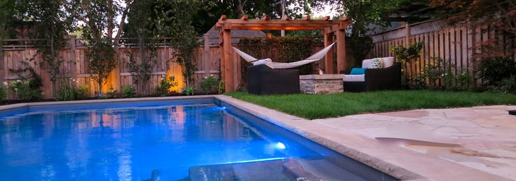 We have had a lot of fun pulling together this fire pit / hammock / pool combo. There is nothing better than open flame when enjoying an evening in the backyard!