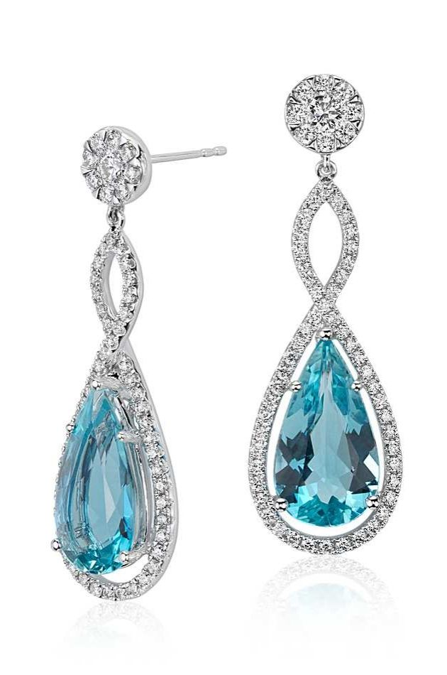 These drop earrings feature 6.88 carats of pear shape aquamarine gemstones set within a diamond infinity twist design.