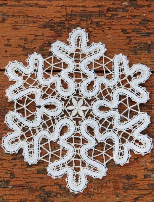 Russian bobbin lace. A stylized snowflake. #Russian #bobbin #lace