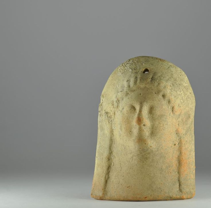 Greek kore votive terracotta protome, 6th century B.C. Magna Graecia, Greek kore votive terracotta protome, one hole for suspension, 11.3 cm high. Private collection