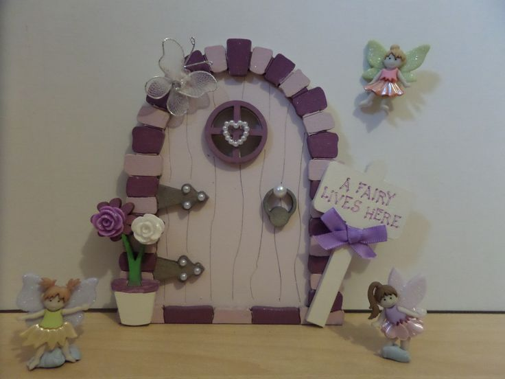 Hand Painted Fairy Door  Add a little sparkle to a little girls room Available to purchase from https://www.facebook.com/elegantfancies