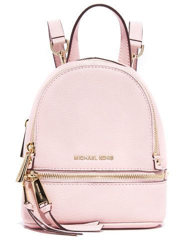 75c5681a4fdd0 Rhea mini backpack by MICHAEL Michael Kors. A petite MICHAEL Michael Kors  convertible backpack in pebbled leather. 2 zip front pockets.