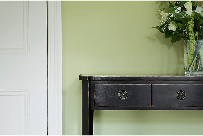 Walls painted green with white trim