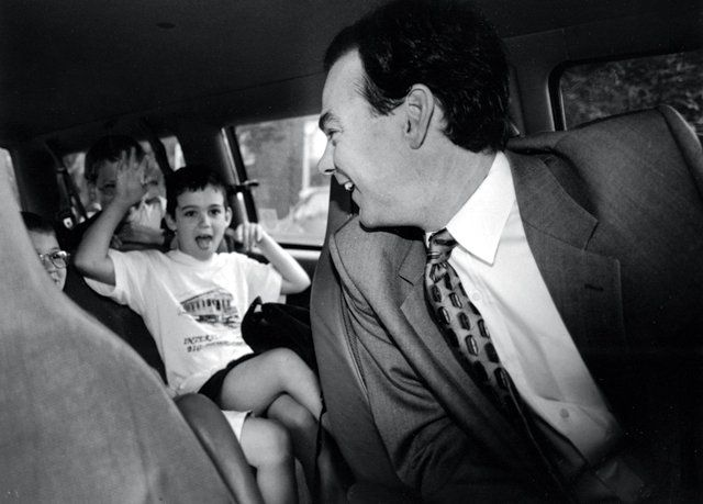 1999: Tim Kaine drops off his son Nat and other kids at Fox Model Elementary School before his mayoral duties of the day begin.