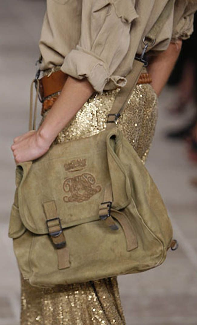 Ralph Lauren (i used to carry a bag much like this one, bought it at an army surplus store in DC)