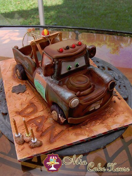 Here is a Sculpted Tow Mater Cake I made to my son for his 3rd. Birthday. It has lots of details that make it look very realistic! One of his favorite characters turned into cake! Of course he loved it!!! :)