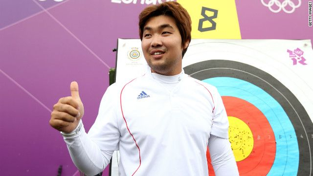 (CNN) -- The first world records of the London 2012 Olympics have been set by a blind South Korean archer -- hours before Friday's much-anticipated opening ceremony was due to begin.  Im Dong Hyun is legally classified as blind and cannot see out of his right eye, but it did not stop the two-time gold medalist bettering his own leading 72-arrow score in the qualification competition at Lord's cricket ground in the British capital.