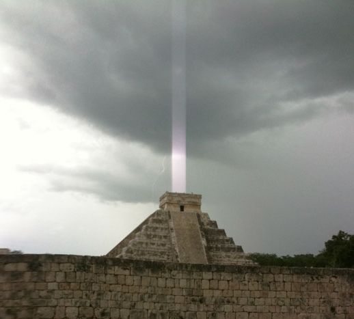 """a Mayan temple on the Yucatan Peninsula in Mexico, with a mysterious """"light beam"""" emerging from the top"""